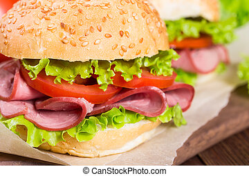 Sandwiches with ham and tomatoes