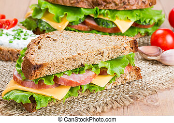 Sandwiches with ham, cheese and fresh cucumber
