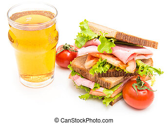 sandwiches with ham, saladf and tomatoes