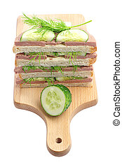Sandwiches with liverwurst on a cutting board