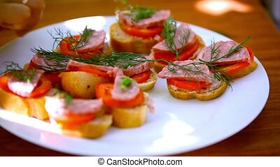 Sandwiches with pate, tomatoes, sausage take off from plate, eat them and leave plate