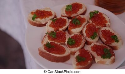 Sandwiches with red caviar on a plate. - Sandwiches with red...