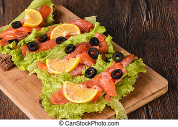 Sandwiches with red fish and lettuce