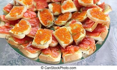 sandwiches with salmon and caviar