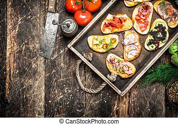 Sandwiches with seafood, salami, bacon and fresh vegetables.
