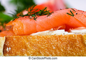 Sandwiches with smoked salmon, cream cheese and herbs.