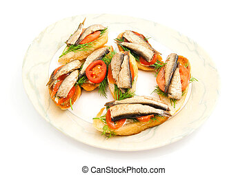 sandwiches with sprats on plate