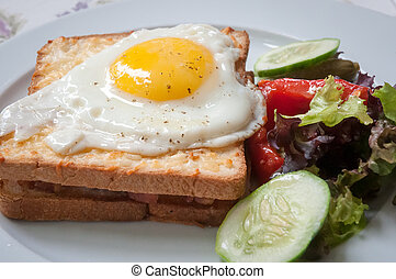 Sandwiches with white bread bacon and egg .
