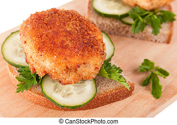 Sandwiches with Yummy Cutlet, Bread, Cucumber and Parsley on...