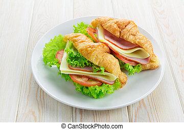 Sandwish croissant on wood