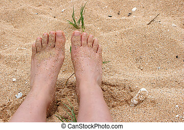 bare feet  - sandy bare feet against Hawaii island ocean