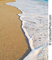 Sandy Beach and Foamy Surf. Summer Background
