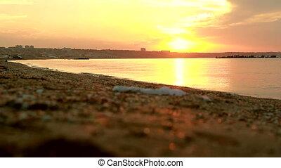 Sandy beach at caspian sea shore. Sunset over the sea edge ...