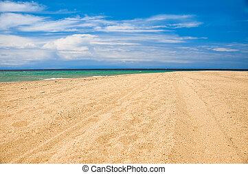 Sandy beach on the azure sea coast