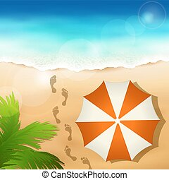 Sandy beach with a beach umbrella
