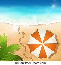 Sandy beach with a beach umbrella