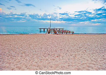 Sandy beach with a pier