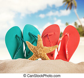 Sandy beach with accessories and blur sea - Summer concept ...