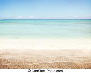 Sandy beach with blur sea on background