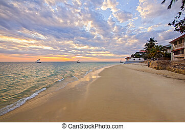 Sandy Beach with Boat and Sunset on Zanzibar
