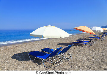 Sandy beach with parasols and sunbeds, Gialos Lefkada Greece
