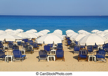 Sandy beach with white parasols and sunbeds Kathisma Lefkada