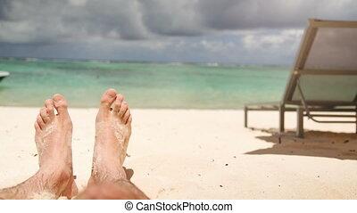 sandy feet at beach enjoy the sun