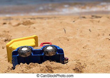 Sandy Plastic Toy Truck on Mediterranean beach