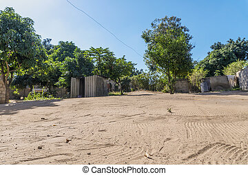 Sandy road in African neighborhood in Maputo, Mozambique