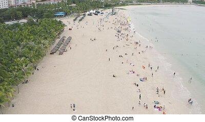 Sandy sea beach - Sandy beach with tourists swimming and tan...