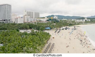 Sandy sea beach - Sandy resort beach with tourists swimming...