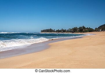 Sandy shore at Sunset Beach park on North Shore of Oahu