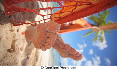 sandy toes vertical - sandy toes of woman relaxing in...