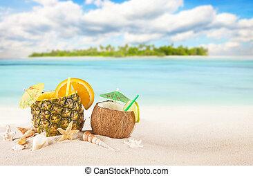 Sandy tropical beach with summer drinks