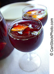 Two glass cups filled with fresh tasty sangria