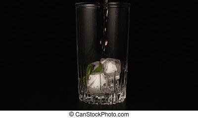 Sangria poured into glass super slow motion