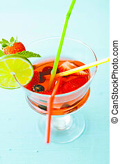 Sangria - sangria with colored straws and strawberries in a...