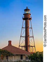 Florida's Sanibel Island Lighthouse is backed by a colorful sunrise sky.