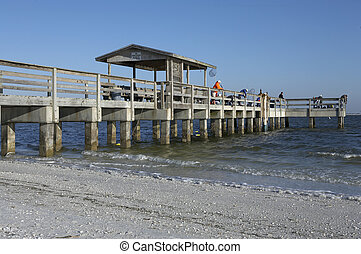 Early morning fishing from the pier at lighthouse beach, Sanibel Island Florida America united states taken in march 2006