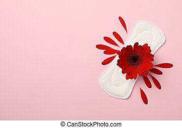 Sanitary pad with gerbera on pink background, top view