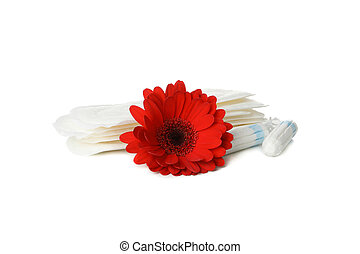 Sanitary pads, tampons and gerbera isolated on white background