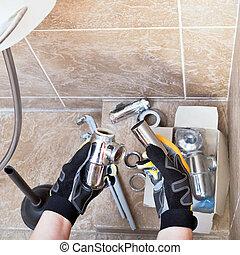 Sanitary technician repairs plumbing trap