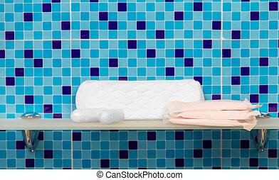 Sanitary towels - beauty treatment on bath shelf