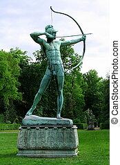 Sanssouci garden sculpture of archer in Potsdam, vertical