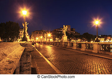 Sant' Angelo Bridge at night, beautiful old sculptures and...