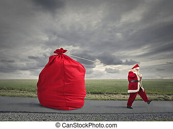 Santa and bag - Santa walking away from bag