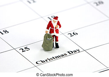 Santa and Christmas day calendar concept - Miniature Santa...
