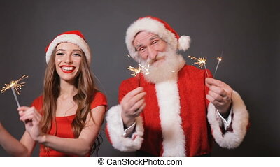 Santa and Helper Dance with Fireworks