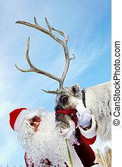 Santa and Rudolph  - Santa Claus stroking his reindeer