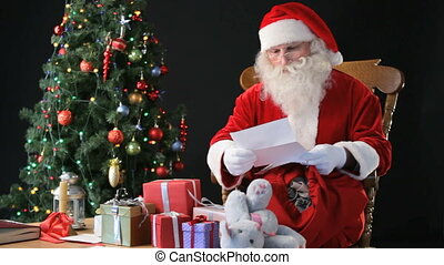 Santa at work - Santa reading letters from children and...